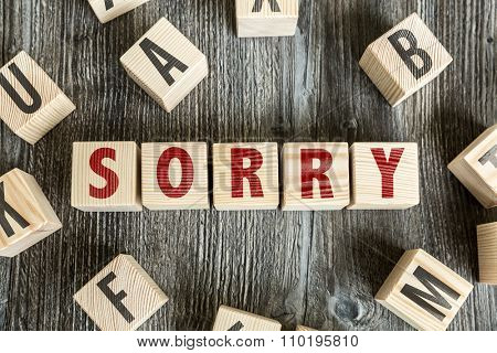 Wooden Blocks with the text: Sorry
