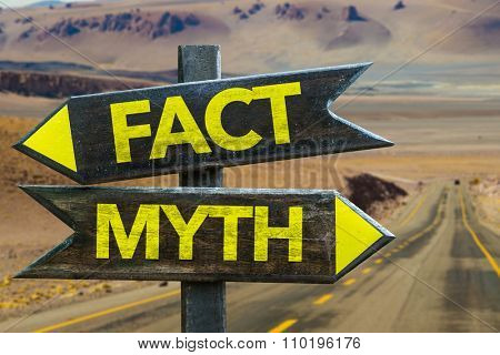 Fact - Myth signpost in a desert road on background