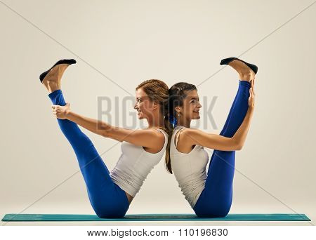 yoga in pair. Balance. figure w