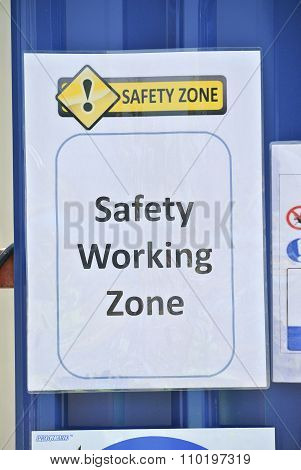 Sign of the safety working zone at construction site.