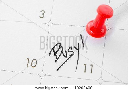 The Words Busy Written On A White Calendar.