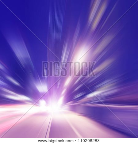 Abstract image of night lights with motion blur  in the city .