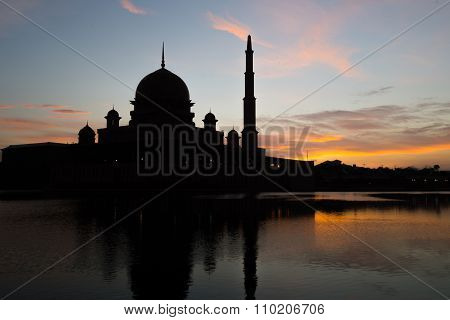 A silhouette of a Mosque during sunrise