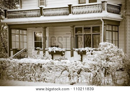 An older home in winter with a sepia effect.