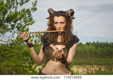 Pretty Female Faun Playing Flute