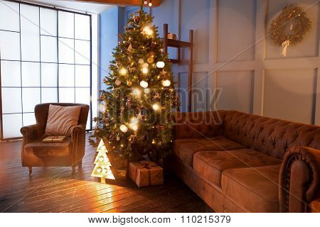 comfortable interior with Christmas tree and a sofa