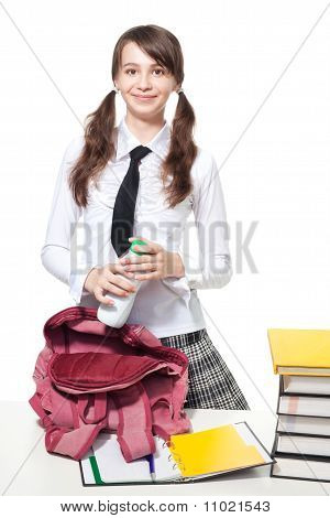 Girl With Bottle Of Yogurt In School