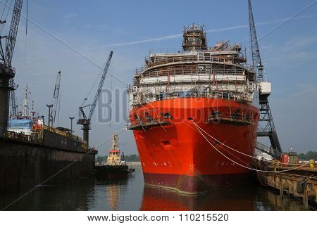 Ship Under Repairs With Scaffolding In Shipyard