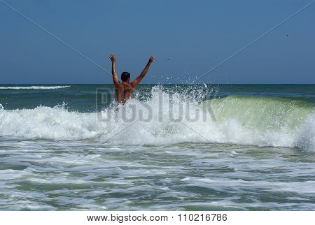 Man Bathing In The Sea