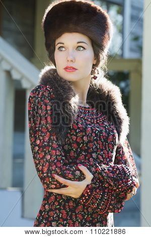Looking Away Russian Beauty In Traditional Fur Cossack Hat And Crossed Arms