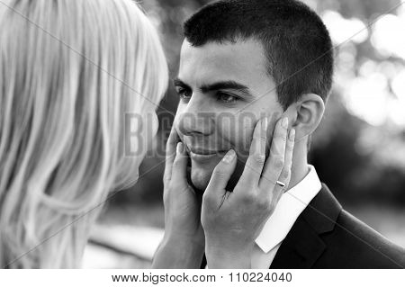 B&w Beautiful Elegant  Blonde Bride Touching Handsome Brunette Groom Close-up