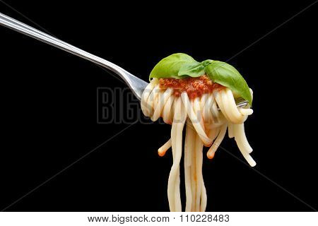 Spaghetti Wound On Fork With Basil Leaf On Black Background