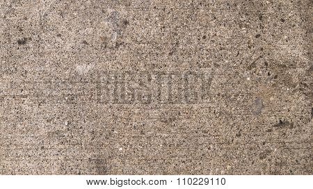 Background With Texture Of Concrete And Pebbles