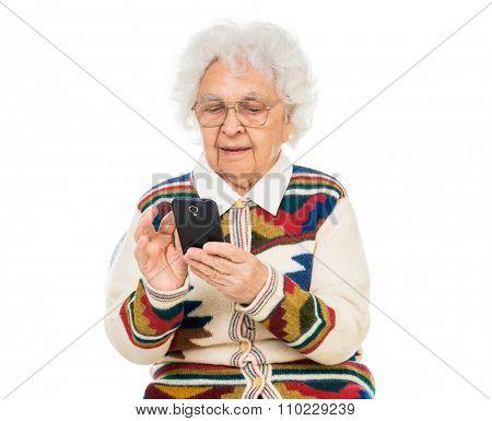 elderly woman using smartphone over white background