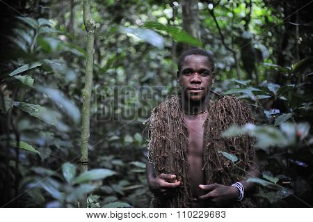 The Hunter-pygmy With A Net Before Hunting. On November, 2, 2008 In Central African Republic.