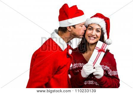 Festive couple exchanging a gift on white background