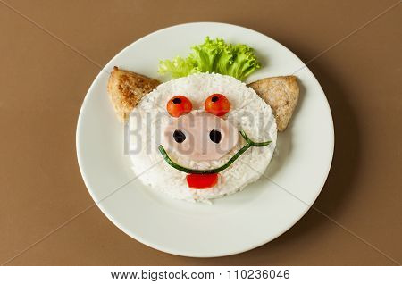 Cheerful pig from rice and cutlets