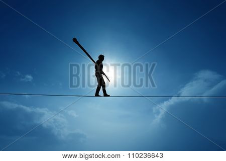 Concept Of Risk Taking And Challenge Highline Walker In Blue Sky