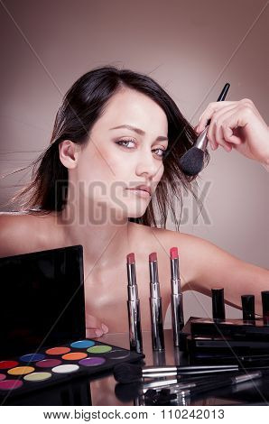 Beautiful Girl With  Brush Near The Face. The Cosmetics For Makeup.