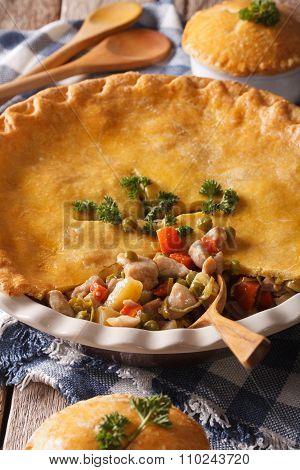Tasty Chicken Pot Pie Close-up In Baking Dish. Vertical