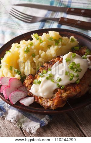 Country Fried Steakwith Potato Garnish Close-up