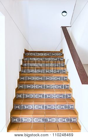 Tile Staircase With A Handrail