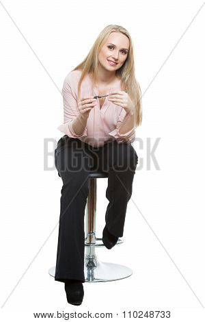 Elegant beautiful woman sitting on a contemporary metal bar stool.  isolated on white. Training mana