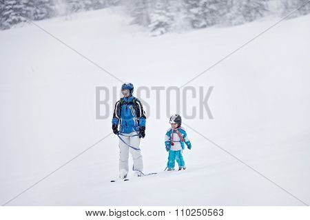 Father And Son, Skiing In The Winter, Boy Learning To Ski