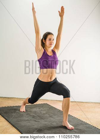 Woman Doing Warrior Yoga Position
