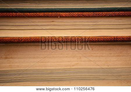 Antiquarian books on wooden table with warm light