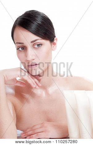 Woman With Well-groomed Skin Near Cosmetics - Isolated On White Background. Skin Care Concept.