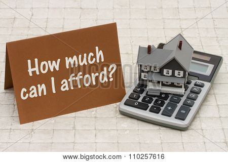 Home Mortgage Affordability, A Gray House, Brown Card And Calculator On Stone Background