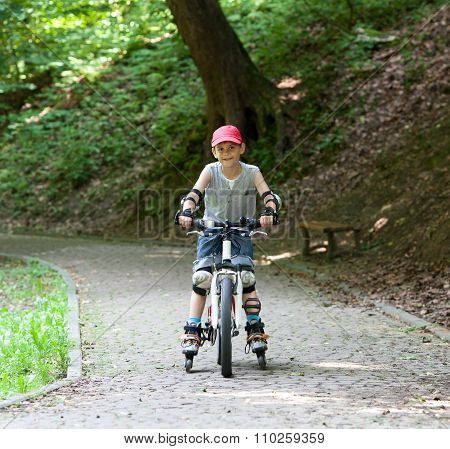 Skates And Bike Boy
