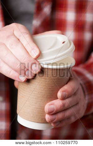 Man Holding Cup Of Takeaway Coffee