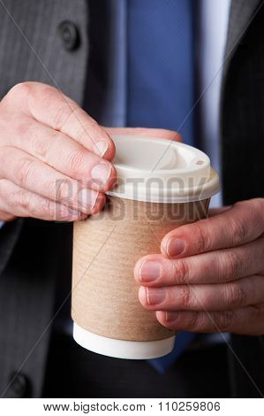 Businessman With Cup Of Takeaway Coffee