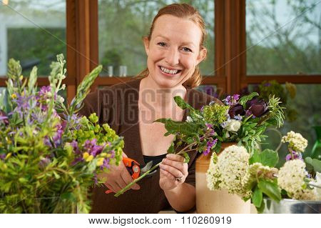 Florist Working On Arrangement In Flower Shop