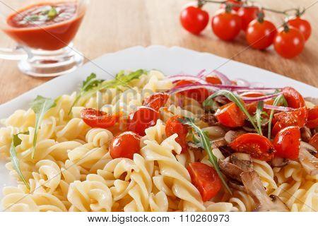Pasta With Mushrooms, Cherry Tomatoes And Tomato Sauce, Italian Food. Closeup