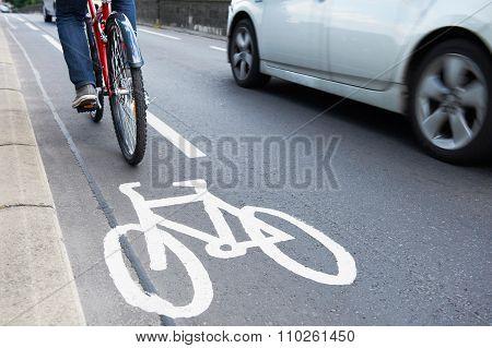 Man On Bike Using Cycle Lane As Traffic Speeds Past