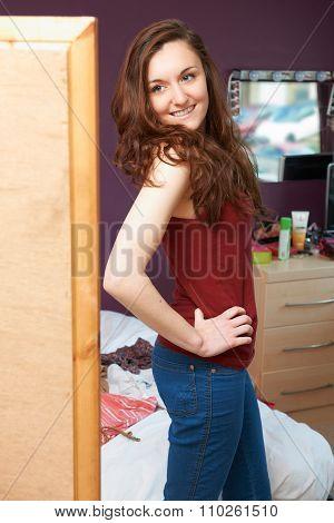 Pretty Teenage Girl Admiring Herself In Mirror