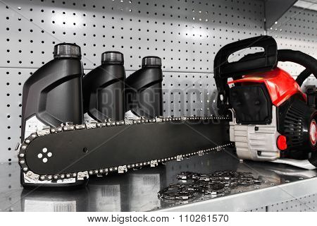 Chainsaw, Oil Bottle Display On Tool Store