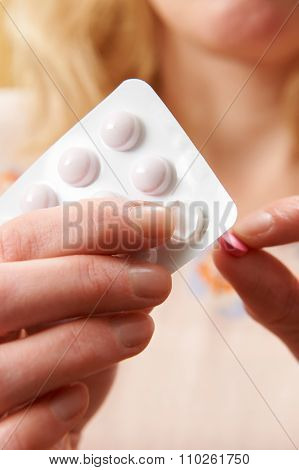 Close Up Of Woman Opening Pills