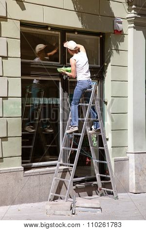 Window Cleaner Working On A Ladder