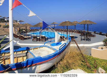 Old Fishing Boat, Sun Beds And Pool On Terrace Over Mediterranean Sea, Santorini