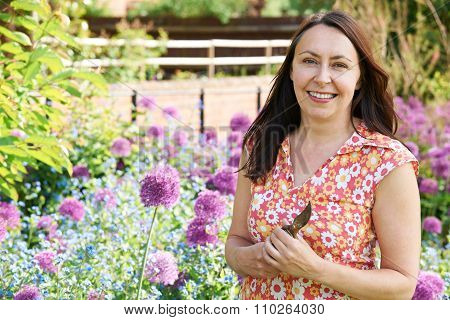 Middle Aged Woman Gardening At Home