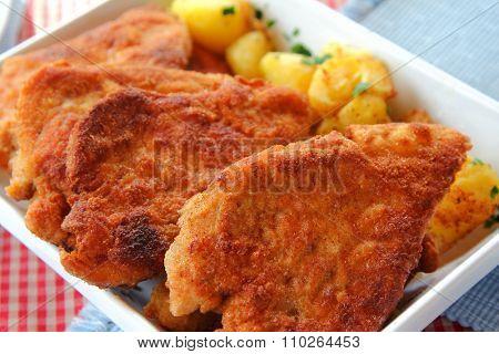 Crispy golden brown color of freshly fried homemade Wiener Schnitzel, national dish of Austria