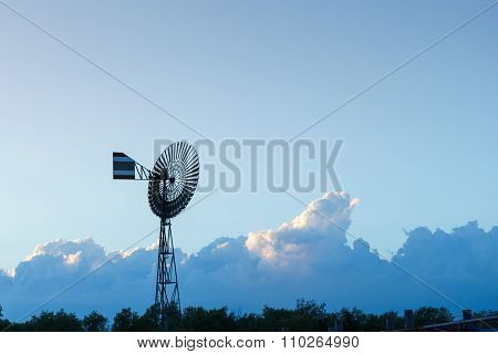 Landscape With Windmill In Blue Sky Background
