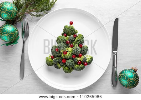 Christmas fir tree made from broccoli, on plate, close up