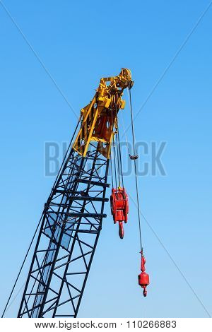 Crane With Hook In Blue Background