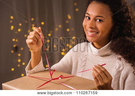 Woman Unpacking Christmas Present