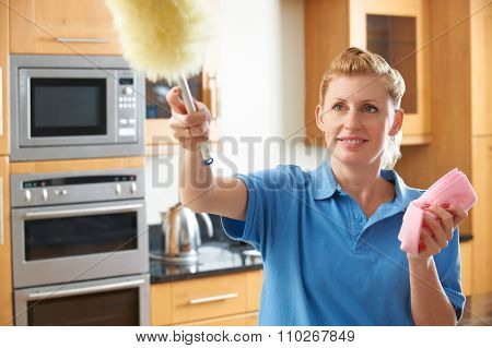 Female Cleaner Working In Kitchen